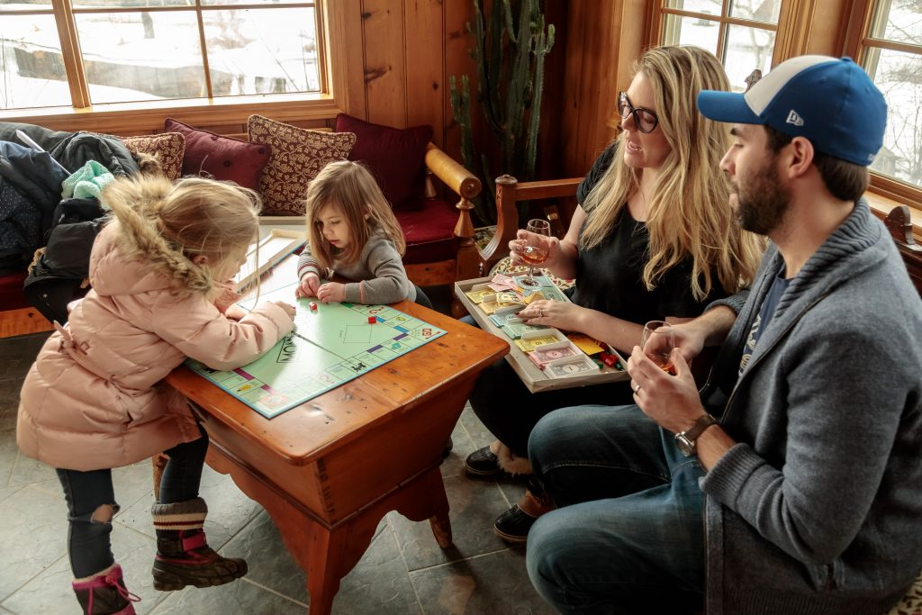 two children playing a board game