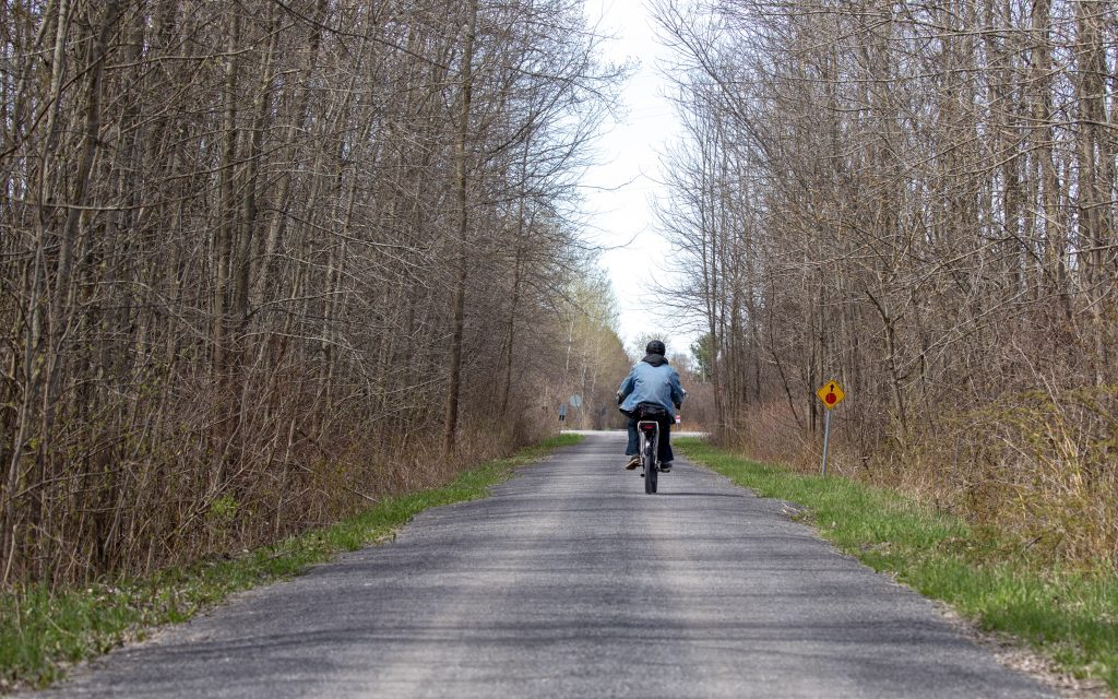 A lone cyclist rides the trail south of 33 in Bloomfield.