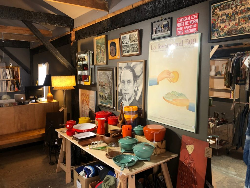 Vintage housewares, posters and clothing displayed at Carbon Life store.