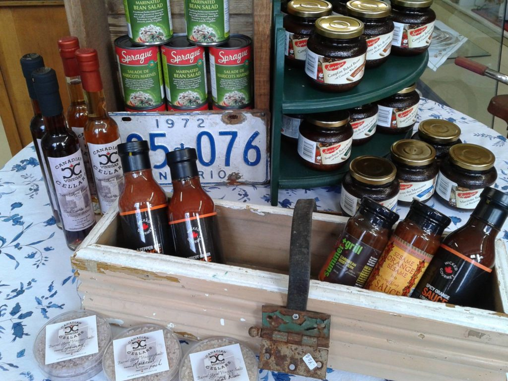 A variety of jams, preserves and hot sauces are displayed.
