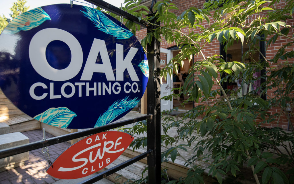 Oak Clothing and Oak Surf Club signs in front of brick building