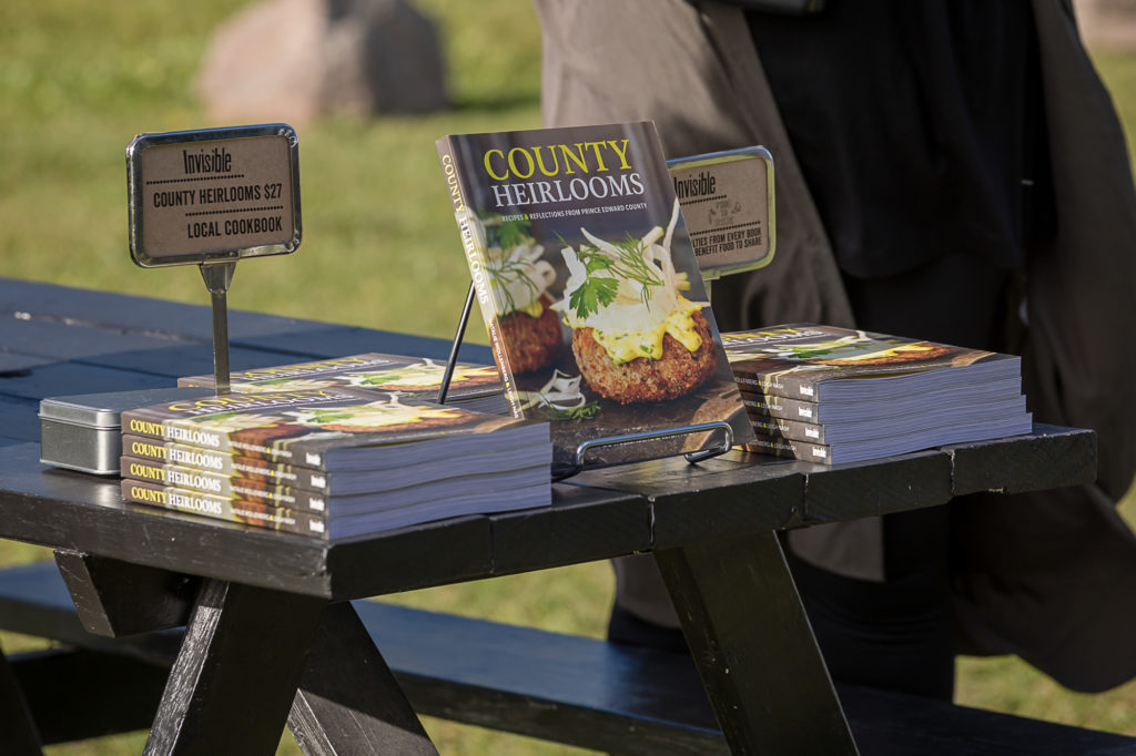 County Heirlooms cookbook displayed on a picnic table.