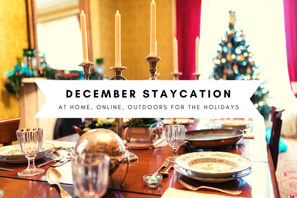 "Picture of a table decorated for a Victorian-era Christmas meal, with a Christmas tree in background. Text on image says ""December Staycation: At Home, Online, Outdoors for the Holidays"""