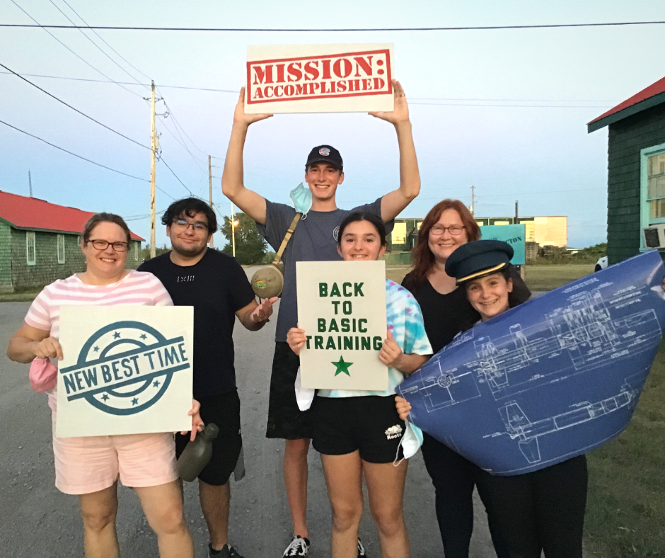 A group celebrates after their reservation for an escape room at Escape Camp Picton.